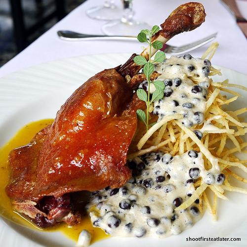 duck leg confit, orange - grand marnier beurre blanc w/ shoe string potato, pigeon peas