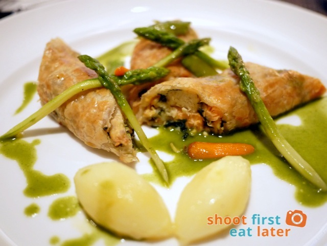 seafood strudel, butter potatoes, herb sauce