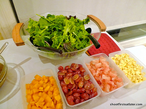 Salad greens w/ mixed fruit, cheese & poppy seed dressing