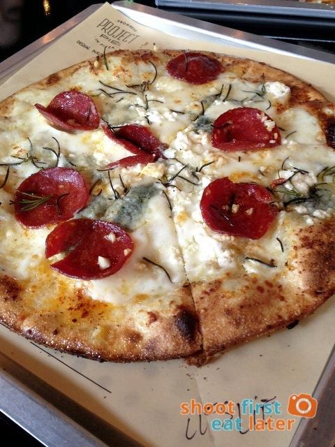 white pizza with double gorgonzola, mozzarella, Parmesan, garlic, rosemary & pepperoni