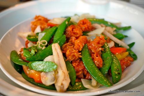 "wok-fried ""coral & gui-hua"" clam w/ sugar peas"