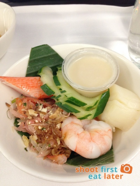poached prawn, scallops and pomelo salad with coconut dressing