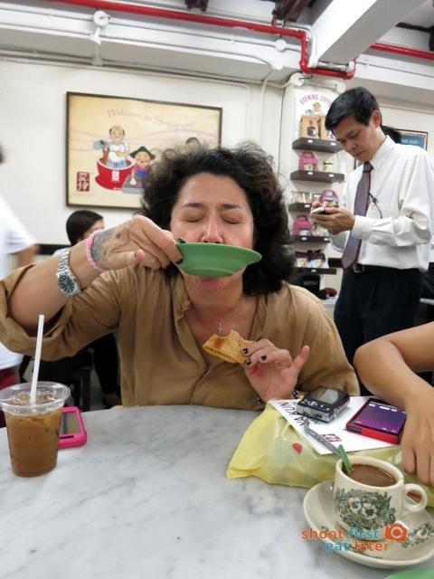 Ya Kun Kaya Toast- Alya demonstrating how to eat a soft boiled egg