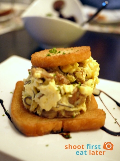 scrambled eggs with baby eels and mushroom