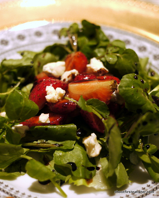marinated strawberries & blue cheese on watercress & arugula